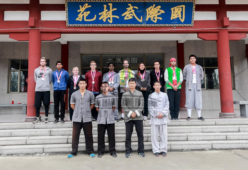 Group picture with shaolin master with earned medals